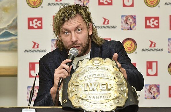 Kenny Omega Sends a Message to Roman Reigns during a Conference