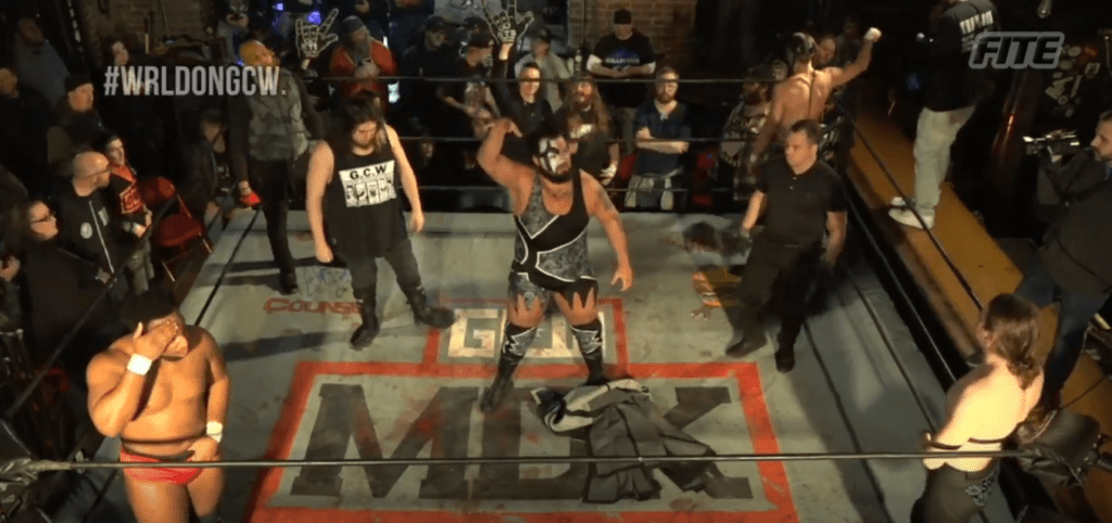 The competitors of the 6 Man scramble stand in the ring