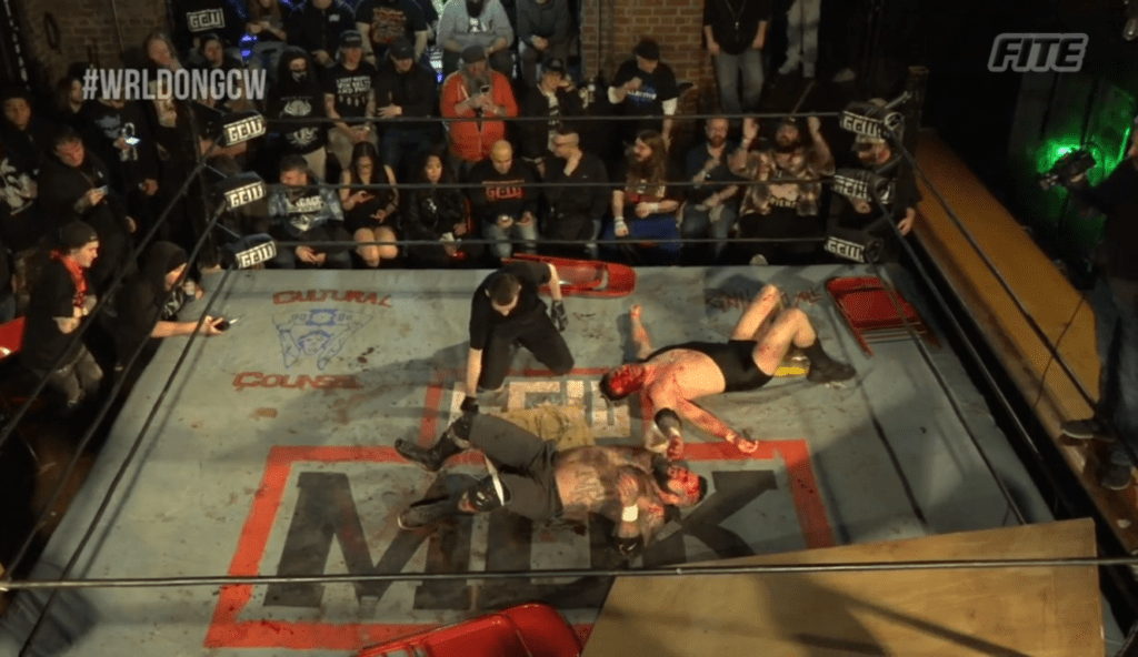 Carnage and violence lay in the ring as Shlak and Jeff King feel the effects of Barbed Wire on their bodies.