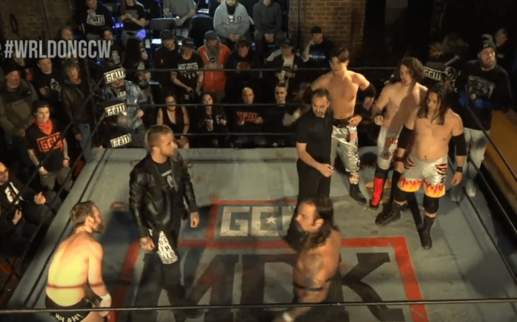 Two hated teams stand in the ring.